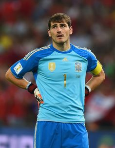 Iker Casillas Photos - A dejected Iker Casillas of Spain looks on during the 2014 FIFA World Cup Brazil Group B match between Spain and Chile at Maracana on June 2014 in Rio de Janeiro, Brazil. - Spain v Chile: Group B Armani Hotel Dubai, Equipe Real Madrid, Fc Porto, Goalkeeper, Cristiano Ronaldo, Chile, Spain, Soccer, Sports