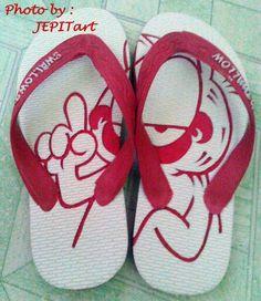 Too slipper carved Price 30.000 IDR. Garfield motif