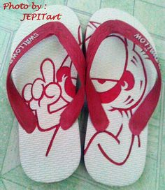 Too slipper carved Price 30.000 IDR. Garfield motif
