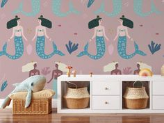 A Mermaid Song wallpaper. Decorate your little loved ones walls with these beautiful mermaids in the ocean. Easy to style with our background colours! Easy do-it-yourself wall fabric. Choose between Peel & Stick Wallpaper or Pasted Wallpaper (Free adhesive). Free shipping above $250 in Australia 🇦🇺 *Background colour can be changed Mermaid Song, Wall Fabric, Removable Wall Murals, Background Colour, Peel And Stick Wallpaper, Mermaids, Colorful Backgrounds, Adhesive, How To Remove