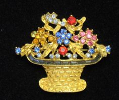 See photos below description. Excellent condition.<br/><br/>The base of the brooch is gold plated basket weave and is brimming with colorful rhinestone flowers in shades of blue, red, peridot, pink, aqua and red. A row of blue channel set baguettes is set at the top of the basket. | eBay!