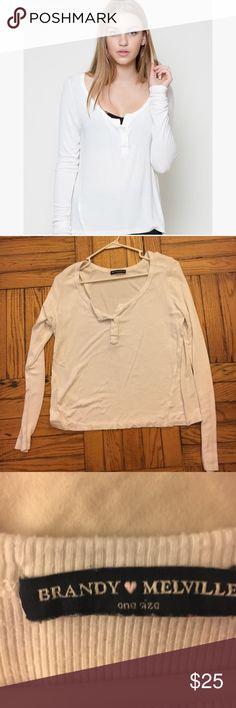 Brandy Melville White long sleeve top Brandy Melville White long sleeve top, buttons 1/4 down, one size Brandy Melville Tops Button Down Shirts