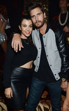 Scott Disick in a very trendy baseball jacket with a leather sleeve.