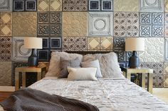tin ceiling tiles on wall as headboard, painted, 6 patterns; mix of scales, each pattern locally painted the same color; american tin ceiling company;Industrial Bedroom by Contour Interior Design, LLC