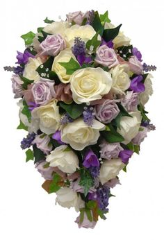 A beautiful shower tear drop bouquet, this bouquet is made   in a bridal holder with artificial flowers. Featuring in this bouquet   are open ivory Isabel roses, lilac lavender, lilac Chloe roses and    lilac silk freesia's. With light catching crystals, mixed foliages of ivy   leaves and rose leaves and dusky organza bows.    Measurements  Width:- 12 Inches  Length:- 18 Inches
