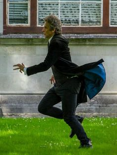 """""""I'll give you a tip – watch him run. It's always hilarious. Stop it, pause it, and go back. It'll be worth it every time. """"Steven Moffat described me as running like a penguin with his arse on fire, which I do – Peter Capaldi Peter Capaldi Doctor Who, Doctor Who 12, 13th Doctor, Twelfth Doctor, Doctor In, Tv Doctors, I Like Him, Amy Pond, Jenna Coleman"""