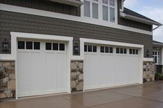 Love these simple garage doors with the gray, clean lined shakes. Not sold on the stone that far up on the wall though.