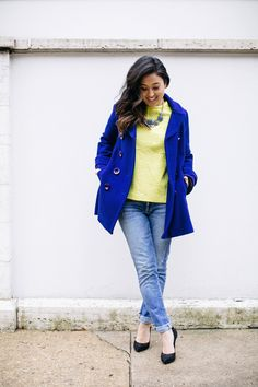 blue pea coat and neon green top