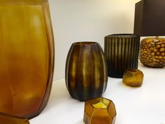 GUAXS Vases in clear/gold and butter/brown - Cubistic Tall, Cubistic Tealight, Koonam M,Omar M and Somba Tablelamp M. #bensshop #bensstore #munich #interiorshop #decoration #living #lifestyle #guaxs