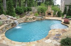 Inground Swimming Pool And Spa With Waterfall And Fireplace