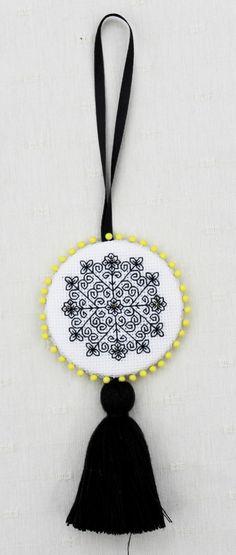 Persian flower, designed by @Elizabeth Almond, from Blackwork Journey, finished as a scissor keeper.