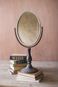 Oval Iron Mirror on a Stand