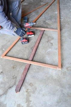 How to make an easy DIY outdoor Christmas tree light display frame for your yard or even your apartment balcony using scrap or new trim wood #christmaslights #christmasoutdoor