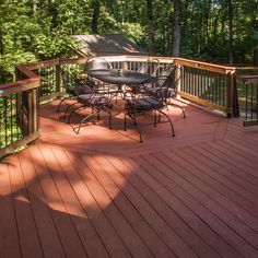 Pressure-treated deck and covered pavilion deck for hot tub. Designed and built by Atlanta Decking. Decking Fence, Oil Based Stain, Fencing Companies, Decking Material, Backyard, Patio, Deck Design, Pavilion, Natural Wood