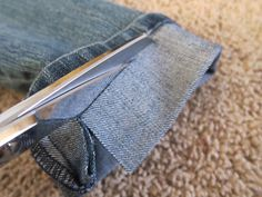 How to hem jeans  Put the jeans on, find where you want your jeans to lay and pin it. Roll the jeans up so that the original hem is slightly above that mark, and pin it.  Sew right next to the original hem.   Cut off the extra fabric.   Unroll it and iron it flat... Thats it.
