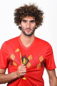Marouane Fellaini of Belgium poses for a portrait during the official FIFA World Cup 2018 portrait session at the Moscow Country Club on June 2018 in Moscow, Russia. Consigue fotografías de noticias de alta resolución y gran calidad en Getty Images World Cup Russia 2018, World Cup 2018, Fifa World Cup, Poses, Moscow, Polo Ralph Lauren, June, Club, Portrait