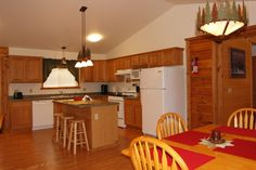 The extra large kitchen and dining area in our Golden Eagle Villa (s) is perfect for any kind of gathering.