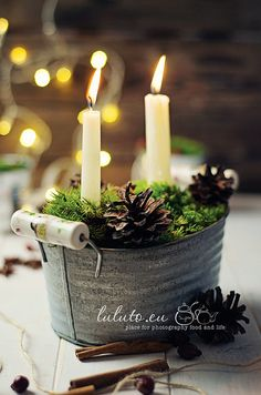 Candles in a galvanized bucket with moss and pinecones Love this, simple beauty!!