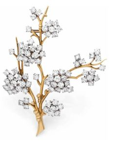 A DIAMOND, YELLOW GOLD AND PLATINUM BROOCH BY Van Cleef & Arpels. CIRCA 1960