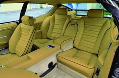 Lamborghini Espada: Calling these seats borders on blasphemy. Fine leather upholstery greeted driver and passenger alike. The Espada was designed to transport four adults in mellifluous luxury.