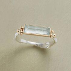 SCULPTED AQUA RING -- A sculpted band lends an organic sensibility to our exclusive Emily Amey aquamarine baguette ring. Handcrafted in USA with recycled metals: 14kt gold bezel, sterling silver band. Whole sizes 5 to 9.