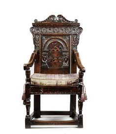 A fascinating and rare Charles I oak and inlaid joined panel-back open armchair, Yorkshire/Derbyshire, dated 1631
