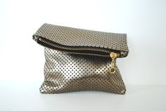 Leather mini clutch in antique gold. $40.00, via Etsy.
