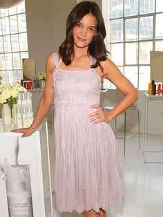 TRESSED UP A perfectly coiffed Katie Holmes helps launch the new Alterna Haircare line – she's the company's spokeswoman – in New York on Wednesday.