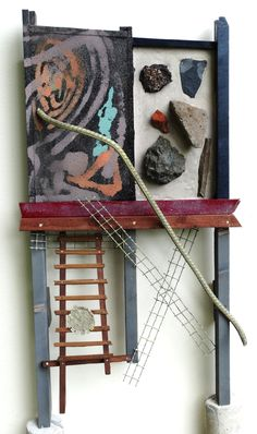 Stairway to heaven or earth: Throughout our lives / the question whether to take / the staircase to heaven or earth / remains without concrete answer. // This assemblage / may help to make the proper decision / or to make the wrong decision.  (assemblage, stones, wood, cement, paint, metal; most recycling material, size 79x44x18 cm; www.meurtant.exto.org)