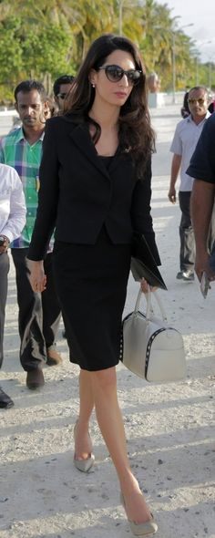 Amal Clooney rocks her black suit with neutral accessories.