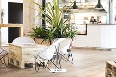 cool whitewashed pallet table and modern chairs at this bakery