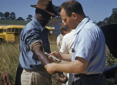 """Dr. Walter Edmondson draws blood from a research subject during the Tuskegee syphilis study.  """"The Tuskegee Study of Untreated Syphilis in the Negro Male"""" was a clinical study conducted between 1932 and 1972 in Tuskegee, Alabama in which 399 poor--and mostly illiterate--African American sharecroppers were denied treatment for syphilis. The individuals who enrolled in the study did not give informed consent and were not informed of their diagnosis...Photo credit: The Public Health Service"""