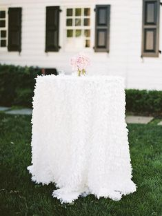 We LOVE the look of these White Leaf Petal Tablecloths by www.BellaAngelEventDecor.com