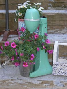"""Up-cycling old kitchen implements and appliances as containers gives a whole new meaning - and a healthy dash of charm - to the term """"kitchen garden""""."""