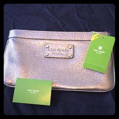 Authentic Kate Spade Metallic Clutch/Pouch!! Gorgeous & Authentic Kate Spade Metallic Clutch. Comes w/Original Tag & Authenticity Card! Awesome Color-Matches w/Anything! Inside is Lined w/a Navy Blue/Almost Black Fabric w/ lil White Polka Dots Throughout! 2 smaller open pockets r on 1 side & a Bigger Zipper-Pocket runs along the other side. This Item is in Excellent Condition,except (as shown in photo #3), Part of the Zipper is Broken. The Zipper itself Still Works Perfectly,& u cant notice…
