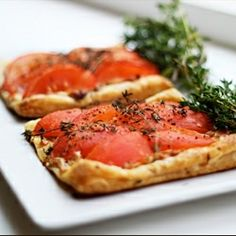 Oven roasted tomato and goat cheese tart with caramelized onions