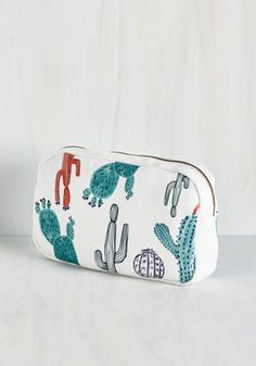 You and Cacti Makeup Bag. Stash your cosmetics in style with this handy makeup bag by IMM Living, which is covered in an array of sassy succulents! #multi #modcloth
