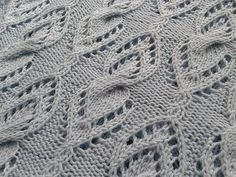 Ravelry: Cabled Lace Cowl pattern by Rahymah