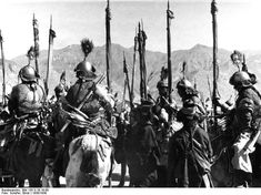 Tibet cavalry wearing riveted mail hauberk with mirror armor, steel helmet, armored belt. Tibet, New Year's Parade, 1938 / 1939. These festivities included shooting a bow and musket from a horse.