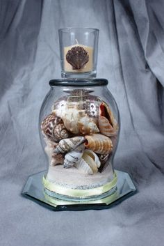 Bring some summer into your home with our seashell collection. Your choice of either a set of wine glass centerpiece or a hurricane centerpiece