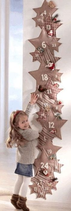 Unique DIY advent calendars you've never seen before - DIY CandyUse old toilet paper rolls and scrapbook paper to create a meaningful DIY Christmas advent calendar that can hang in the door. This recycled project Christmas Makes, Noel Christmas, Homemade Christmas, All Things Christmas, Winter Christmas, Christmas Ornaments, Christmas Sewing, Christmas Projects, Holiday Crafts