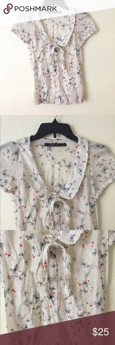 🆕 Zara trf Collared Button Down Butterfly Blouse Lovely white collared button down blouse with butterfly and heart design. Tie neckline. 100% Cotton. Gently worn 💗 Zara Tops Blouses