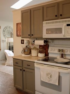 Grey cabinets and white appliances - finally a cute kitchen with something other than stainless steel!