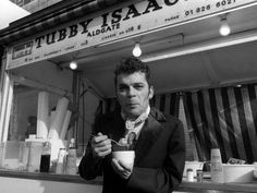 Ian Dury Outside the East End Stall of Tubby Isaacs Eating Bowl of Jellied Eels SwitchArt™ Print Jellied Eels, Old London, London Pride, East London, The New Wave, Youth Culture, Budget Fashion, Fashion Tips, Cool Posters