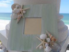 Beach decor accent mirror with shells