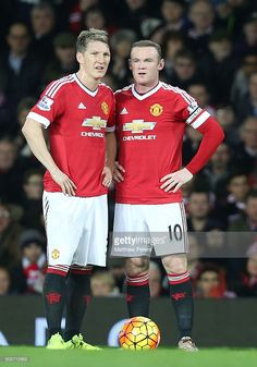 Bastian Schweinsteiger and Wayne Rooney of Manchester United discuss a free kick during the Barclays Premier League match between Manchester United and Chelsea at Old Trafford on December 28, 2015 in Manchester, England.