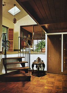 1970s Home Decor dark walnut wood stairs & entryway foyer