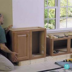 you can use kitchen cabinets to make built-in window seat and bookshelves