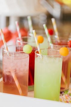 Mother's Day Brunch - Juice Glasses Garnished with Melon Balls + Striped Straws :: The TomKat Studio for HGTV