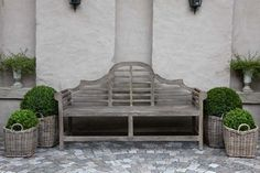simple vignette with bench & potted plants